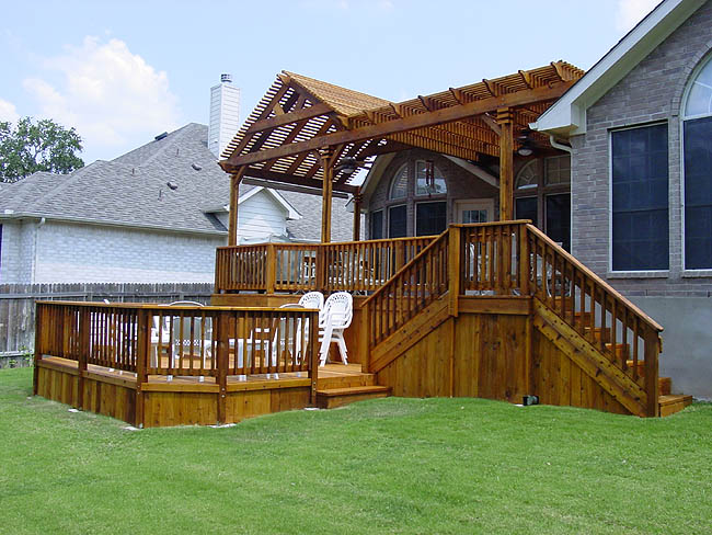 Custom deck with upper deck, hot tub area and stairs